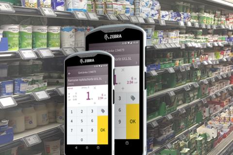Das Bild zeigt Zebra-Geräte mit der Software Mobile Store und im Hintergrund eine Filiale.